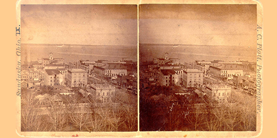 In this stereo image from the 1860s Cooke's home is the two-story limestone Greek Revival house in the foreground. Image courtesy of Sandusky Library Archives Research Center